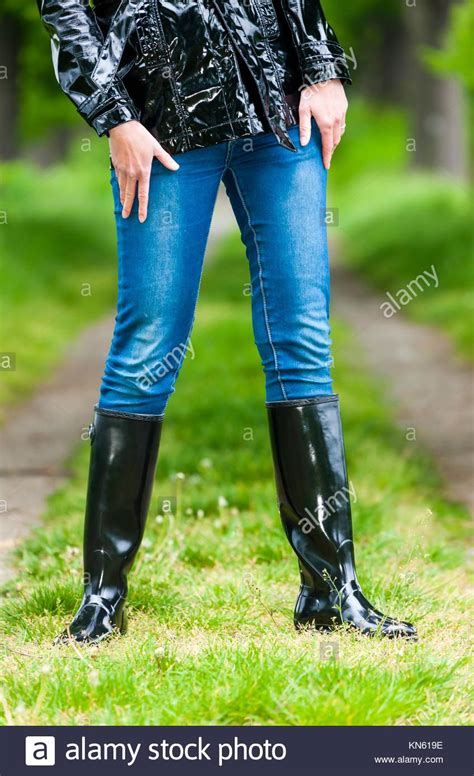 wearing rubber boots wearing wellington boots stock photos