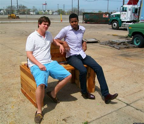 people sitting on bench sit on it detroit vows to keep installing benches at bus