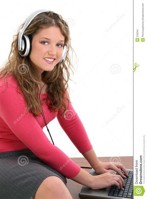 beautiful teen beautiful teen girl with headphones and laptop stock photo