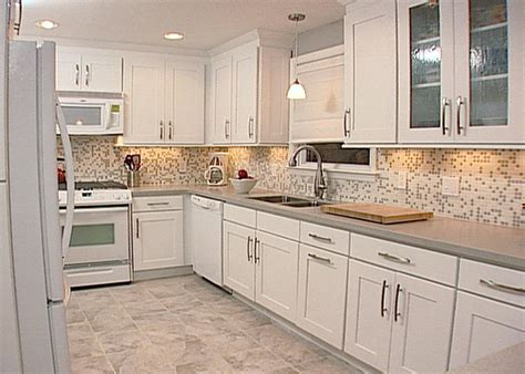 monochromatic modern white maple cabinets with recessed panels and simple chrome hardware set