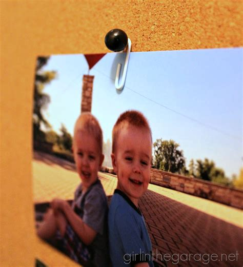 hang pictures without holes how to hang a photo on a cork board without poking a hole