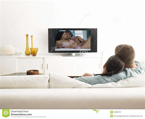 couch online tv back view of affectionate couple on sofa watching