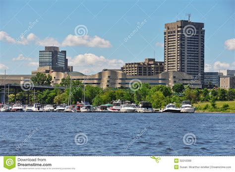 boat graphics ottawa hull marina and view of the city of gatineau editorial