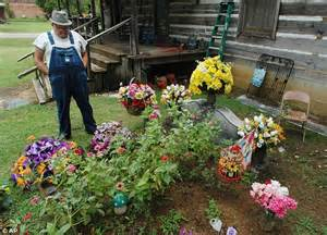 davis fights to keep buried in front yard