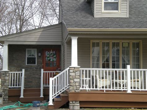 side porches new side entry and front porch with new work pavers redwood decking white vinyl raild