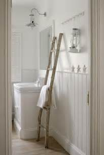 Ladder to display vintage table cloths simply white amp nautical bath