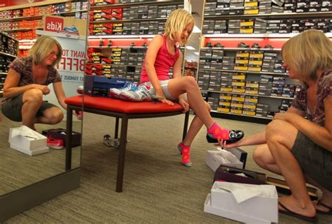 athletes foot shoe store shopping footwear emphasizes athletic brands for back to