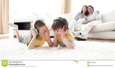 laughing children listening   headphones royalty