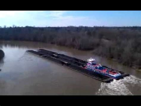 towboat hits vicksburg bridge barge sinks after it hits mississippi river bridge in v