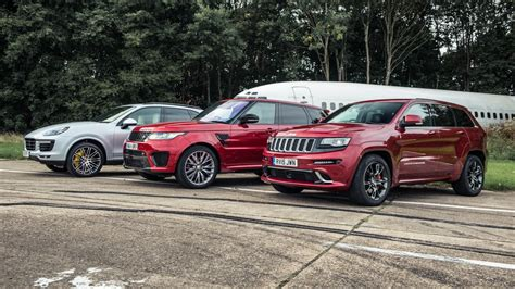 racing jeep cherokee cayenne turbo takes on rr sport svr and jeep grand
