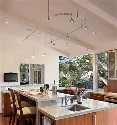 monorail in vaulted ceiling kitchen lighting