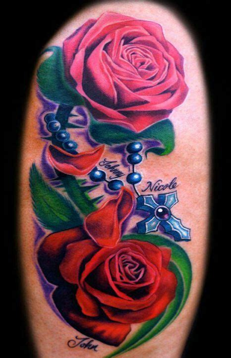 rose tattoo with rosary beads and pink with blue cross rosary bead all