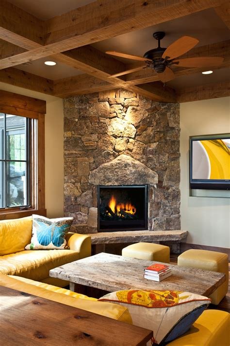 corner fireplace family room rustic with ceiling fan