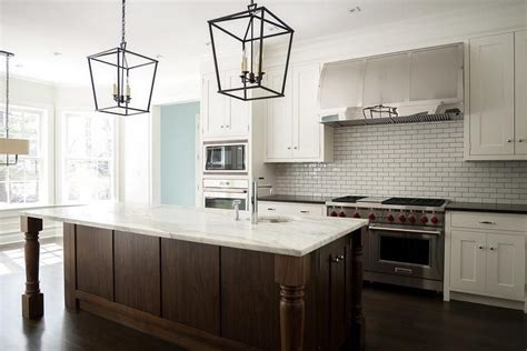 Lovely Kitchen Features White Shaker Cabinets Paired With Brown And White Kitchen Cabinets