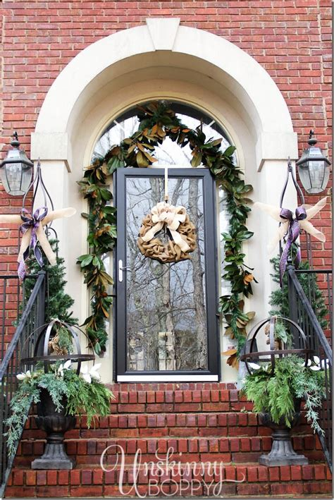christmas decorating huge stone urns in front of entrance and decorating ideas from 32 top home