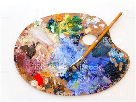 Painting Palette colourful artists paint palette and brush on white