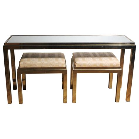 brass console sofa table with matching stools in style of