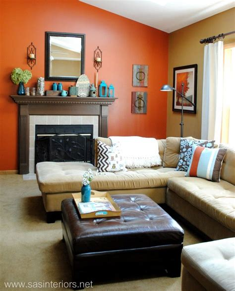 orange accent wall living room like the burnt orange and turquoise of this room homey turquoise