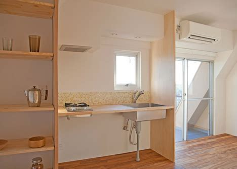 Gets In Kitchen by Tiny Apartment Gets Large Look With Partition Additions