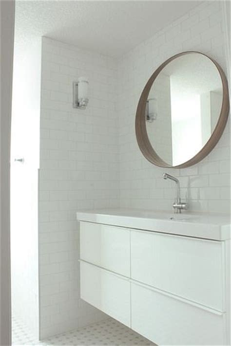 the white black and white tiles and vanities on