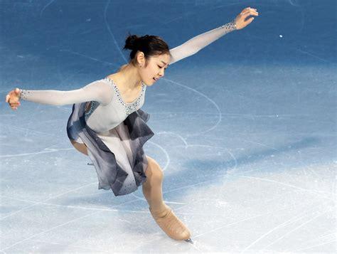 yuna kim figure skating yuna kim in competiton yuna kim photo 24503804 fanpop