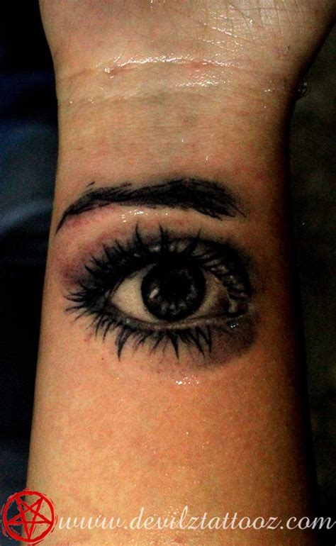 tattoo eye black and grey tattoo art work by tattoo artist realistic eye black and