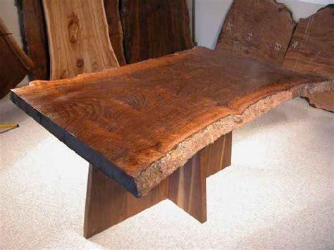 hourglass shaped claro walnut slab custom dining table