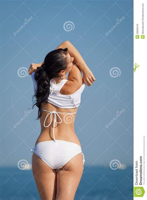 girls undressing in bathroom attractive brunette in white swimwear undressing on the