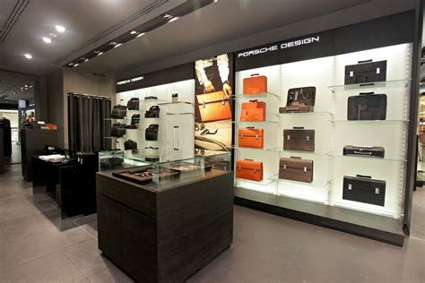 remix design group home store porsche design opens 100th store autoevolution