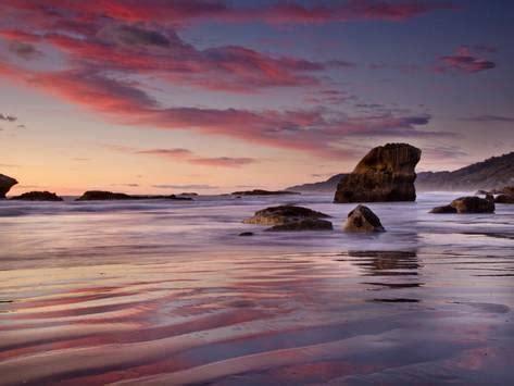 sunset on beach north of punakaiki, paparoa national park