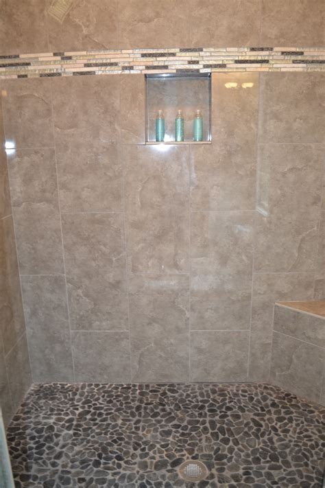 river rock bathroom floor master bath shower floor river rock tile vision pointe homes