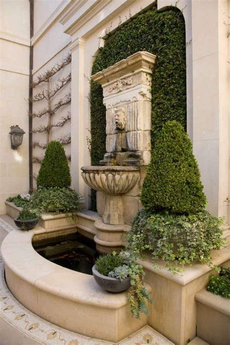 symmetry helps create  restful courtyard   garden