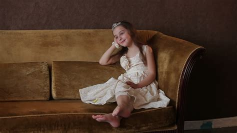 latina couch beautiful little girl posing for a photographer in the