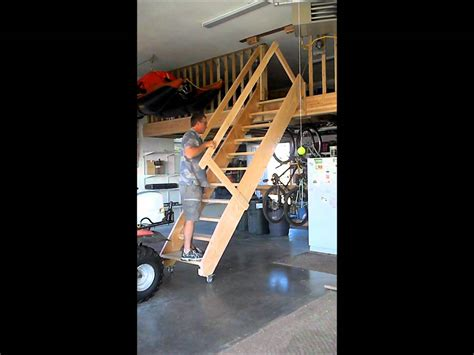 Loft In Garage by Rolling Garage Stairs Wmv Youtube