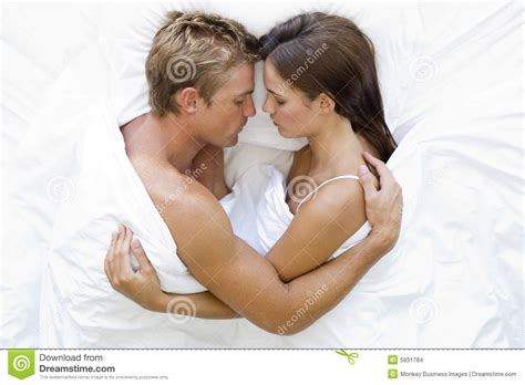 lying in bed all day couple lying in bed sleeping stock photo image 5931784