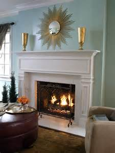 white brick fireplace and blue green wall with decorative
