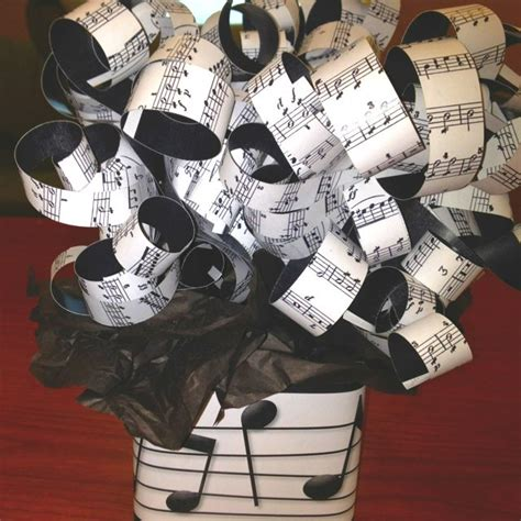 newspaper themed party centerpiece for music themed party printed music in paper