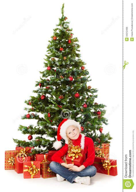 child and petprof xmas tree helper child in santa hat gift box unde stock photo image 34212496