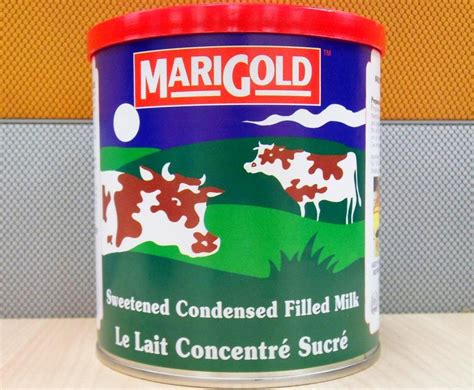 Shelf Of Condensed Milk by Marigold Sweetened Condensed Filled Milk 1kg Products