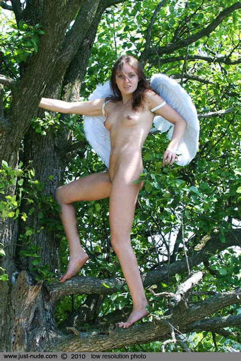 remarkable nymph with angel wings poses naked at a tree youx xxx