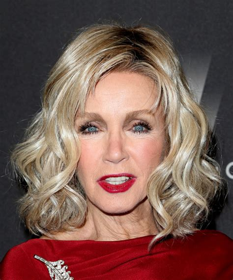 front view of side swept hairstyles donna mills medium wavy casual bob hairstyle with side