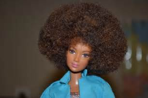 To hand out barbies to girls at booker t washington apartments in