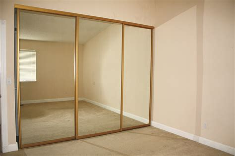 Three Piece Of Sliding Mirror Closet Doors With Beige Thin Hanging A Closet Door