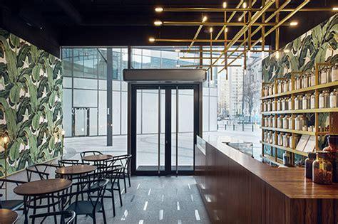 tea house design ugo architecture wraps warsaw tea room in leaf wallpaper