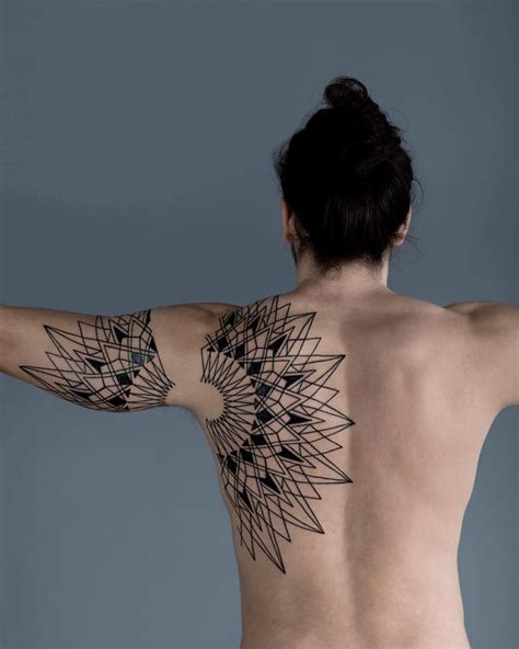 demarcation tattoo quebec striking geometric tattoos inspired by nature s