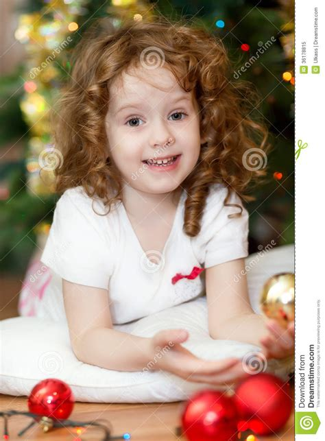 beautiful woman by the tree looking up stock photo image beautiful little baby girl looking at the camera and
