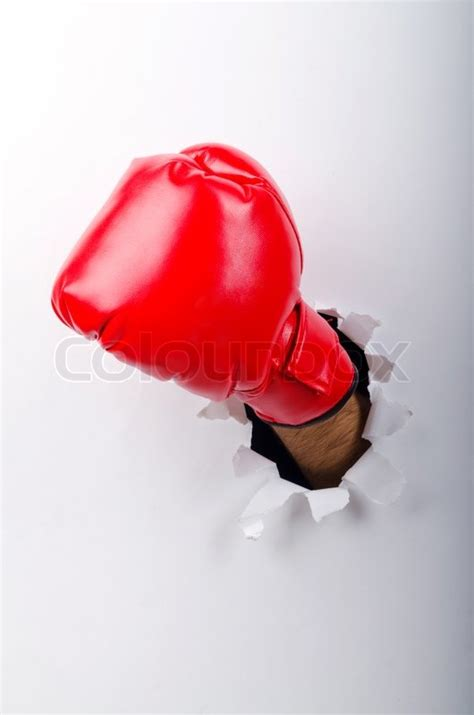 How To Make Boxing Gloves Out Of Paper - in boxing glove through paper stock photo