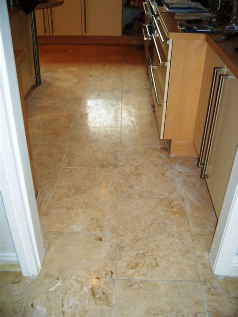 travertine tiled kitchen floor maintained in stockport