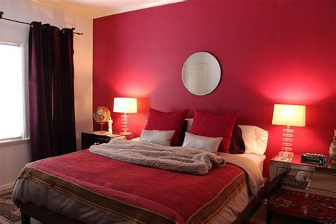 a red bedroom contemporary bedroom with red wall paint circle mirror