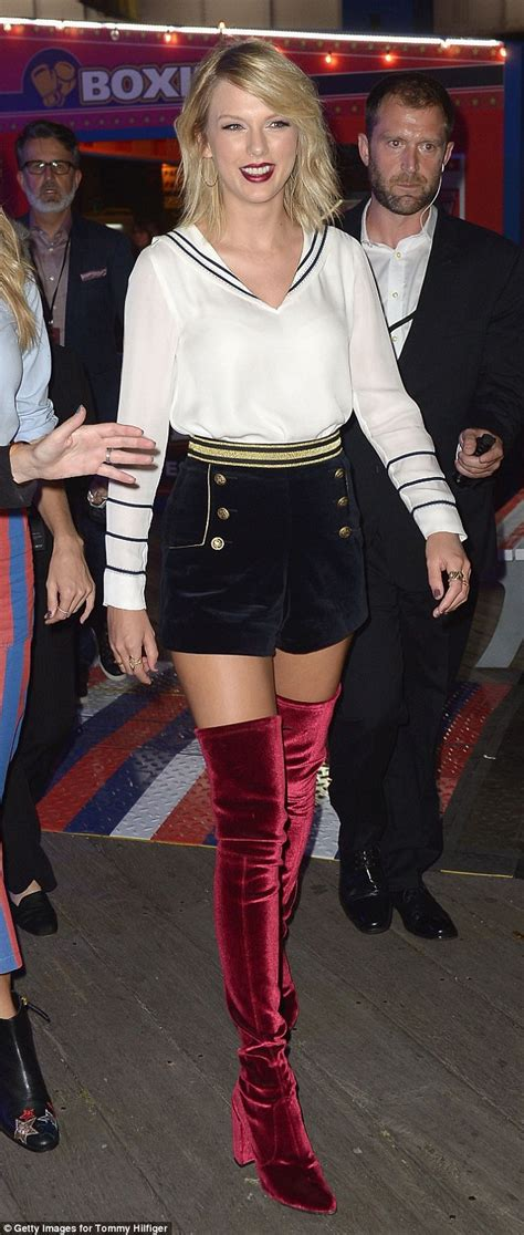 taylor swift stuns  thigh high red boots  shorts